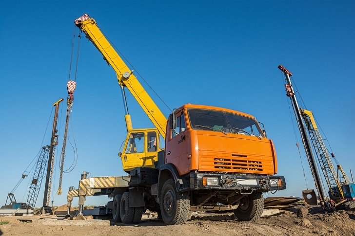 Mobile truck-mounted crane operating at construction site
